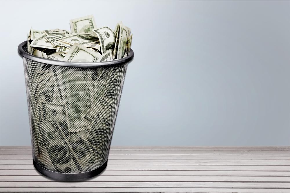 cash in trash can shutterstock_292493912