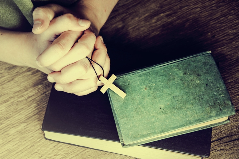 praying hands cross books resized shutterstock_317619533
