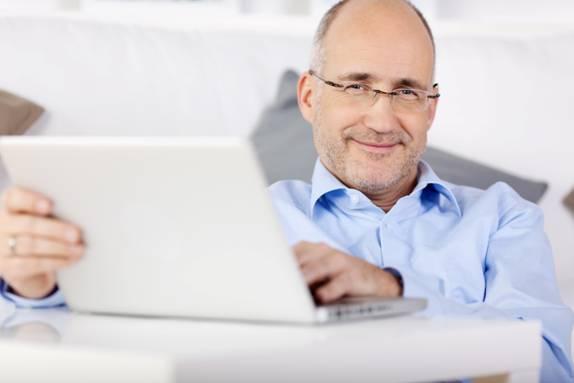 shutterstock white guy collared shirt laptop2